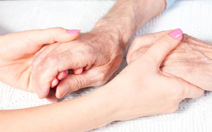 holding-hands-caregiver-patient.jpg